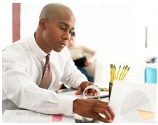 a man evaluating resumes - South Florida Resumes